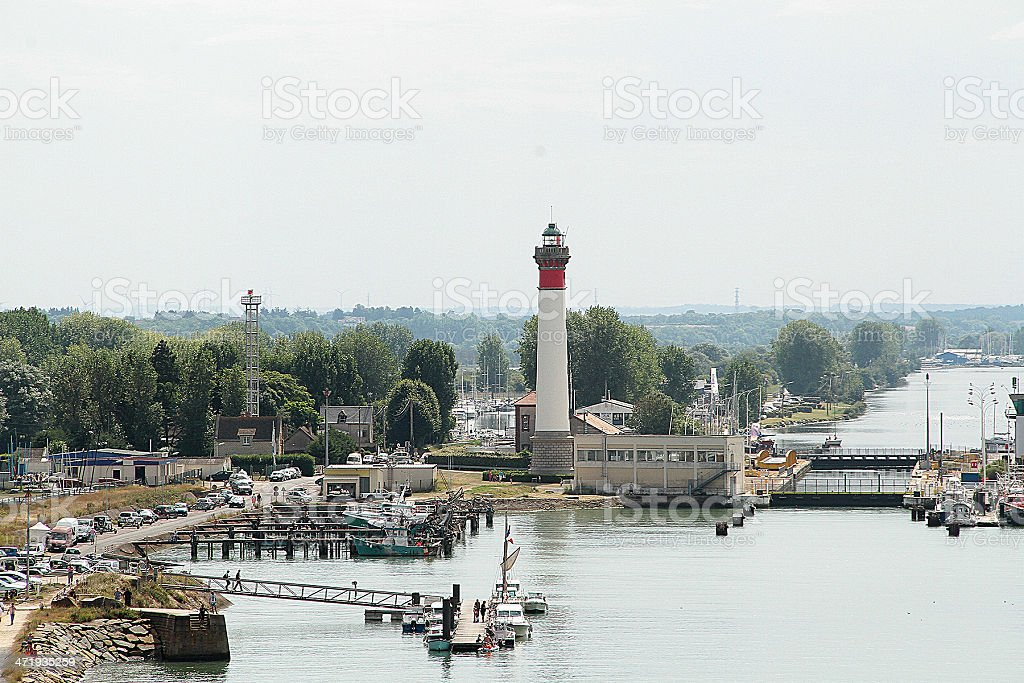 Caen lighthouse and canal in France stock photo