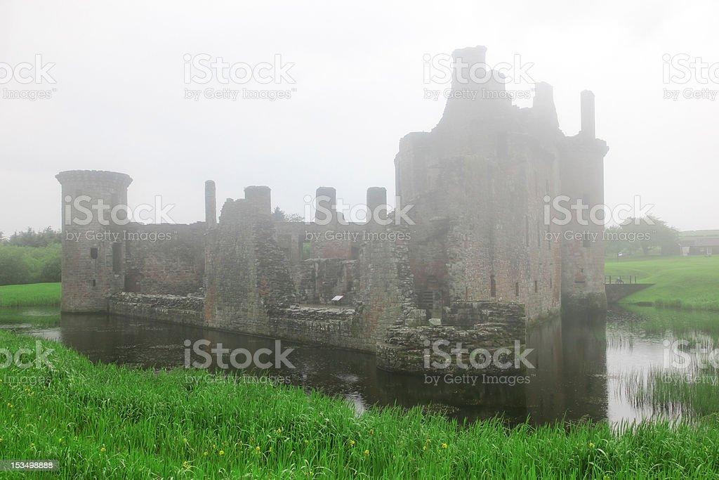 Caerlaverock castle taken in deep fog stock photo