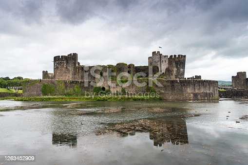 Caerphilly Castle Reflecting in the Moat, in Monmouthshire