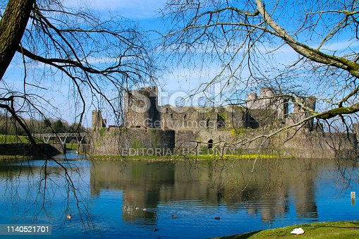 Caerphilly Castle, South Wales, UK March 30, 2019: Caerphilly Castle near Cardiff. The castle is a major feature to Caerphilly town center and a popular area for visitors and tourists visiting wales.