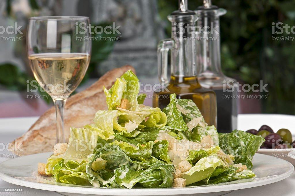 Caesar Salad and wine royalty-free stock photo