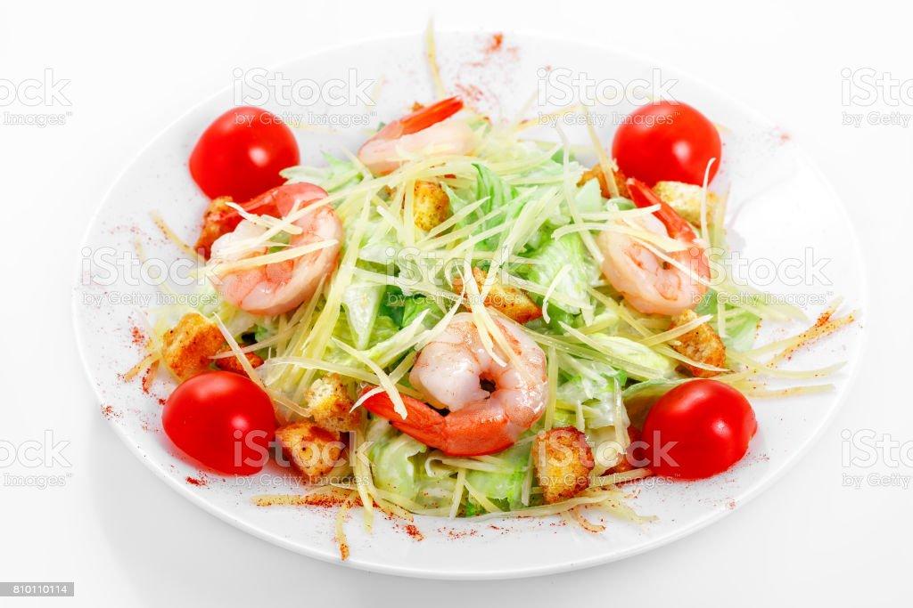 Caesar salad shrimps, iceberg lettuce, parmesan cheese, Caesar sauce, shrimp stock photo