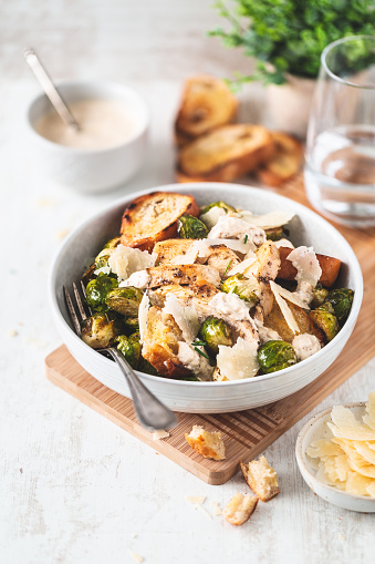 Caesar salad with Brussels Sprouts, Parmesan, Grilled Chicken and Croutons