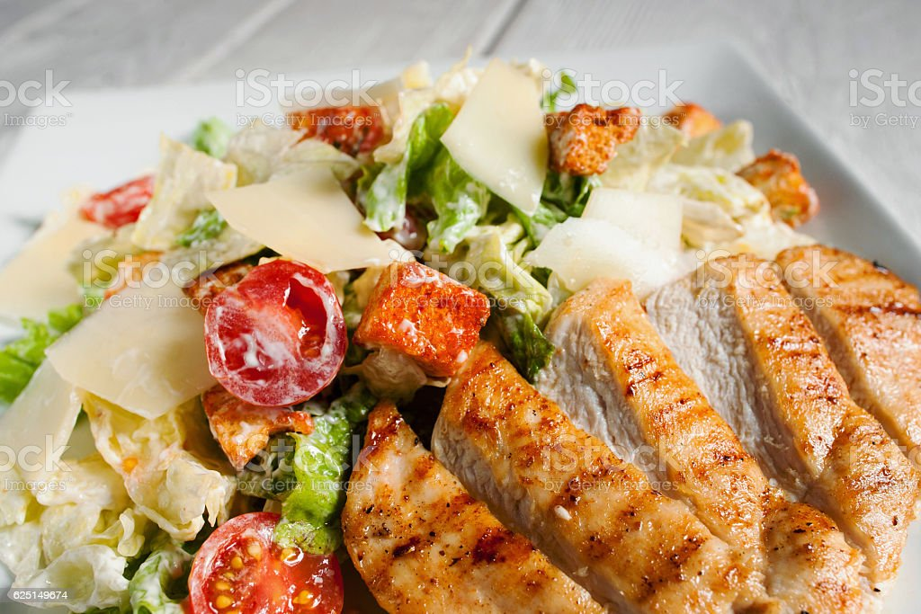 Caesar salad with fried chicken meat, free space stock photo