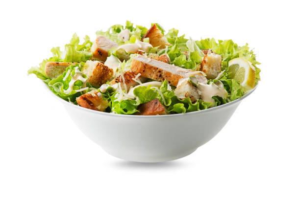 Caesar Salad with grilled chicken and croutons of bread stock photo