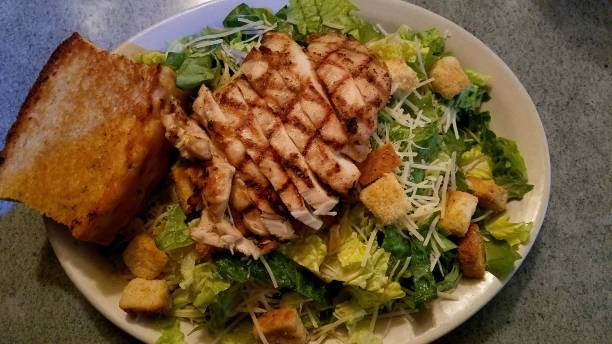 Caesar Salad with Grilled Chicken and Texas Toast, Top View, Close Up stock photo
