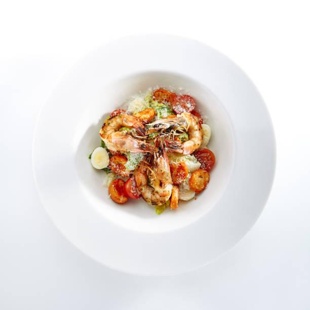Caesar salad with tiger shrimps isolated picture id1015942100?b=1&k=6&m=1015942100&s=612x612&w=0&h=xppl1vlglyf9fykkveqpkljoklm6etrxcb7t2bju0e0=