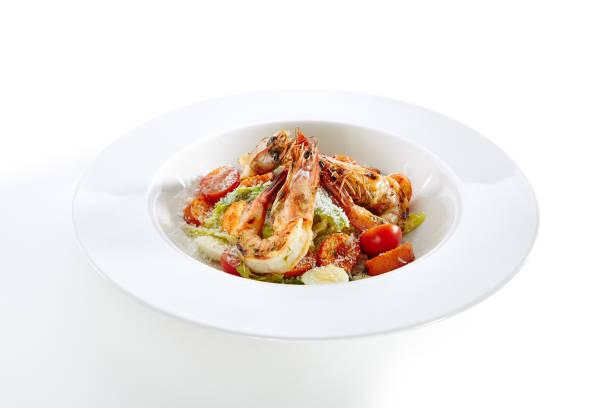 Caesar salad with tiger shrimps isolated picture id1052912336?b=1&k=6&m=1052912336&s=612x612&w=0&h=o6mn3kz2vd 9ohwl hcozufcvxrir84hjm2qc5isutq=