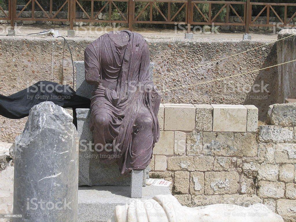 Caesarea. Ancient Roman Cardo street and  porphyrite sculpture of Emperor stock photo