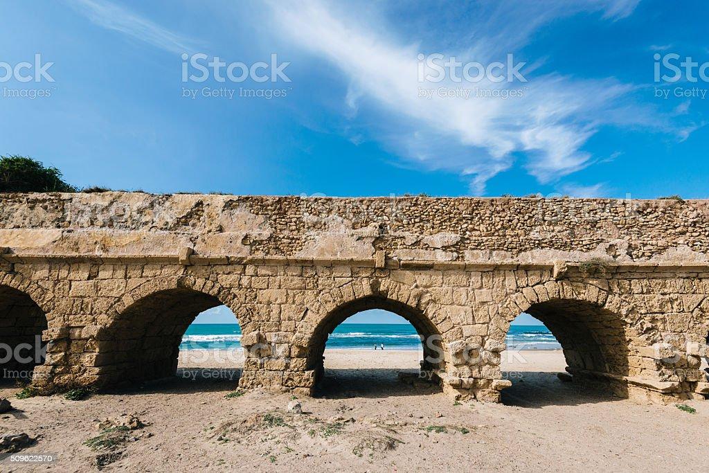 Caesarea aqueduct near Tel Aviv and Haifa on coastline stock photo