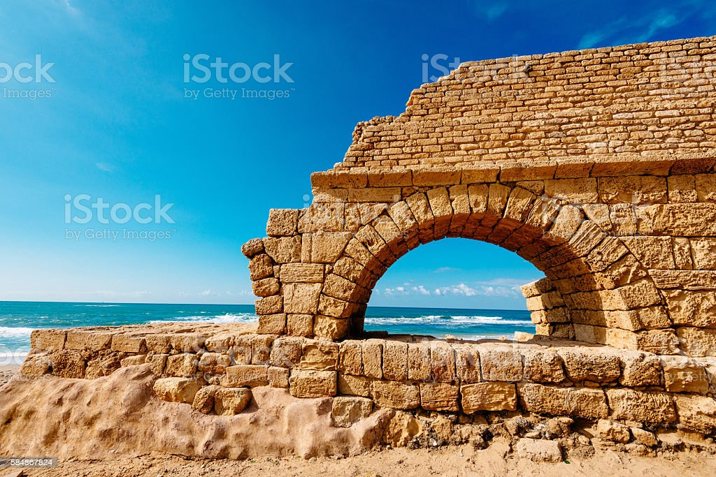 Caesarea aqueduct near Tel Aviv and Haifa on coastline stock photo