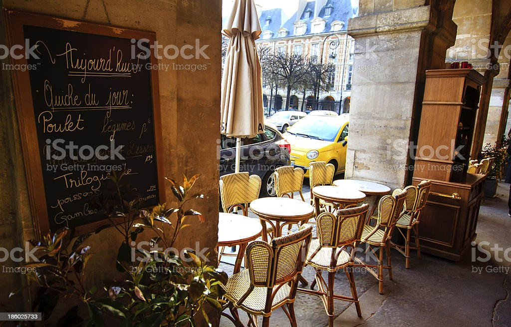 Café at Place de Vosges, Marais, Paris stock photo