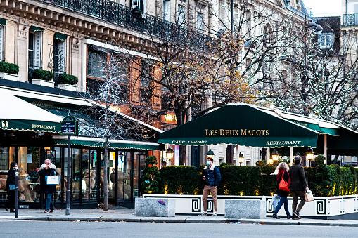 Café Les Deux Magots, in Saint Germain des Près, at Christmas approaches and during pandemic Covid19 - Paris, boulevard Saint Germain, in France. December 5, 2020.