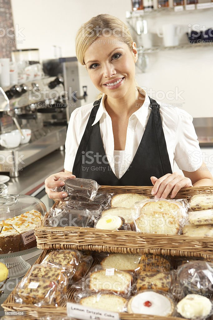 Café Waitress Serving In Coffee Shop royalty-free stock photo