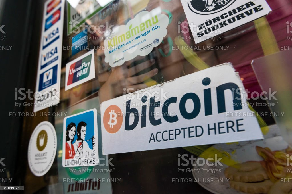 """Cafe accepting Bitcoins and housing Bitcoin ATM Zurich, Switzerland - 2 January 2015: """"Bitcoin accepted"""" sign in the window of """"Kafi Schoffel"""", a coffee bar in Zurich downtown that accepts Bitcoin as means of payment and houses a Bitcoin ATM. ATM Stock Photo"""