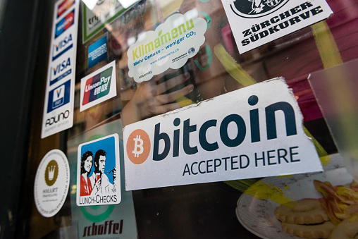 Cafe Accepting Bitcoins And Housing Bitcoin Atm Stock Photo - Download Image Now