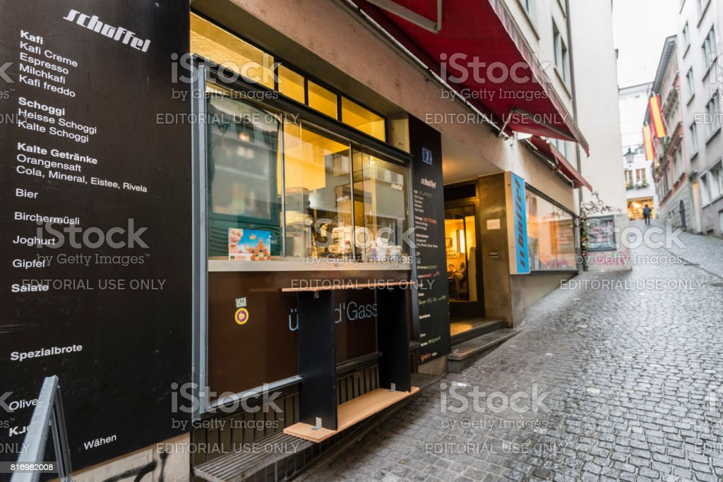 Cafe accepting Bitcoins and housing Bitcoin ATM stock photo