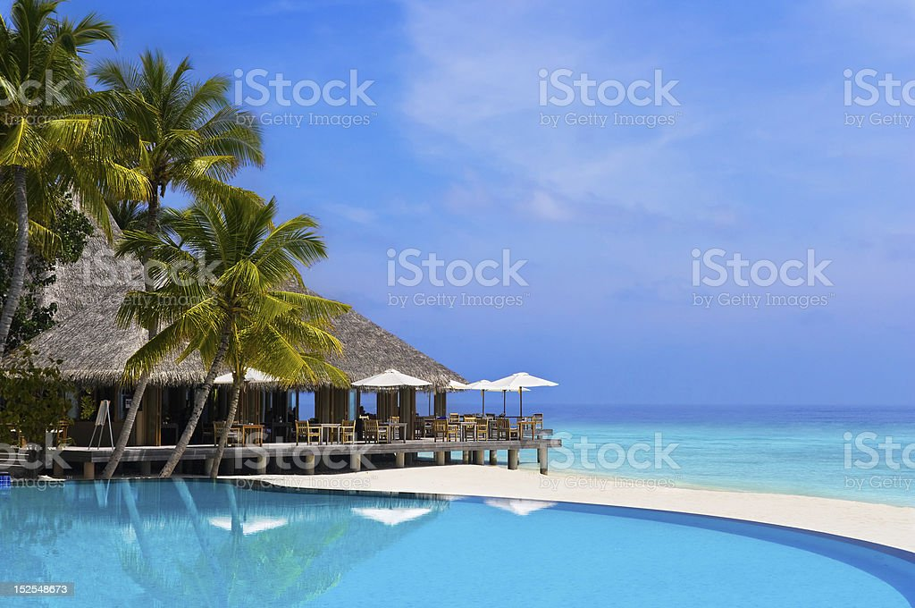 Cafe and pool on a tropical beach stock photo