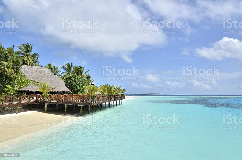 Cafe bar on a tropical beach with clear turquoise waters royalty-free stock photo