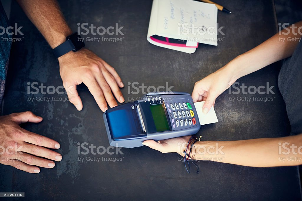 Cafe cashier inserting credit card in reader stock photo