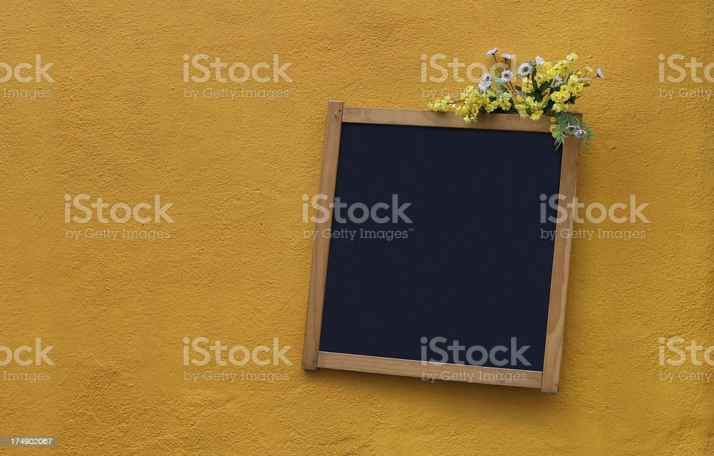 Cafe chalk board hanging on a yellow wall royalty-free stock photo