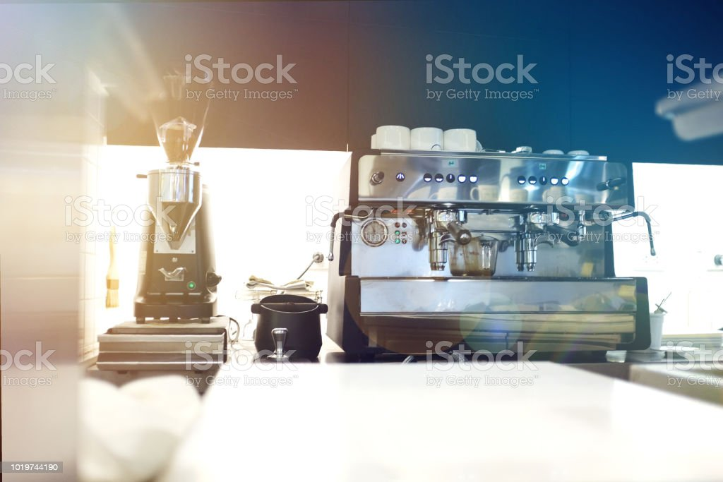 Cafe / coffee shop bar and counter with coffee equipment: espresso...