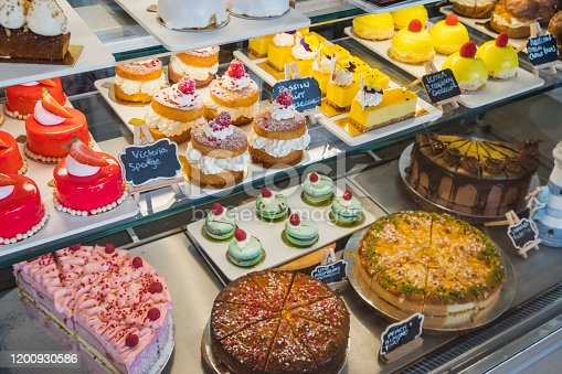 Tempting sweet cakes and tarts for sale in patisserie