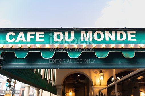New Orleans, USA - April 23, 2018: Cafe Du Monde sign closeup for famous restaurant serving beignet donuts