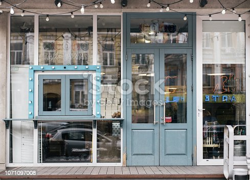 A cafe facade design with stylish elements and furniture. Lot of wooden elements.
