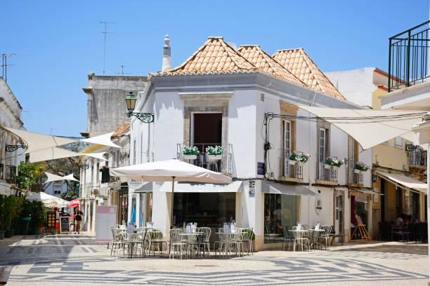 cafe in the old town, faro, portugal. - esplanada portugal imagens e fotografias de stock