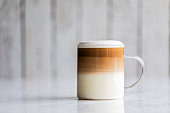 istock Cafe latte macchiato layered coffee 1256257189