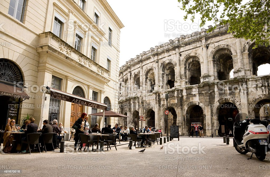Cafe near Roman Arena in Nimes stock photo