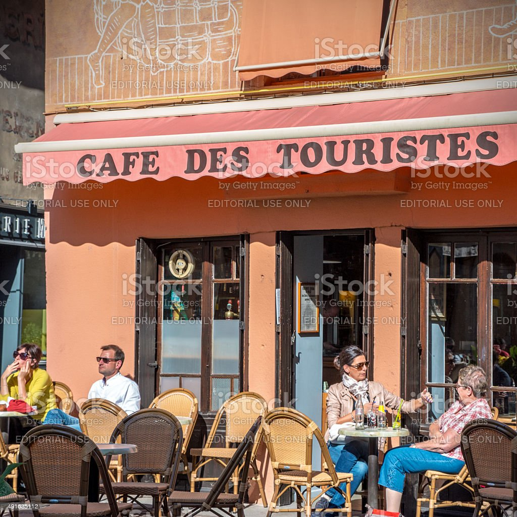 Cafe des touristes french bar in Cremieu city stock photo