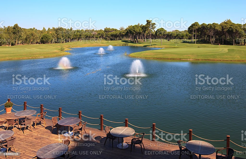 Cafe on the artificial pond with fountain. stock photo