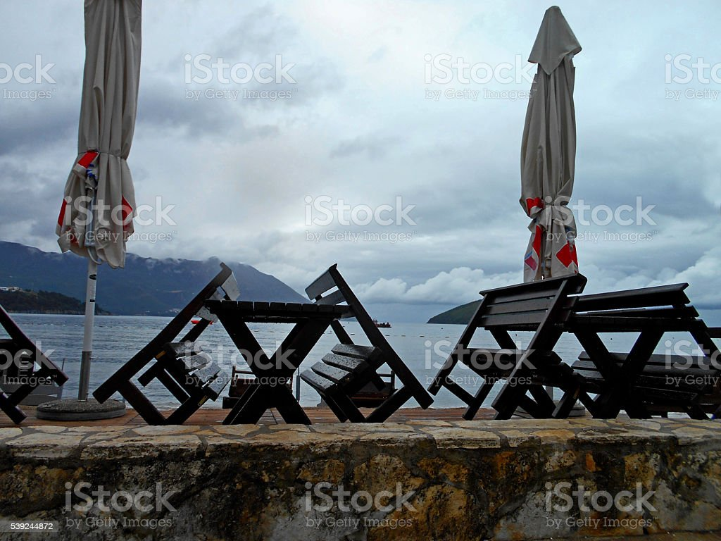 Cafe on the beach while it is raining royalty-free stock photo
