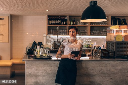 istock Cafe owner standing at the counter 962123066