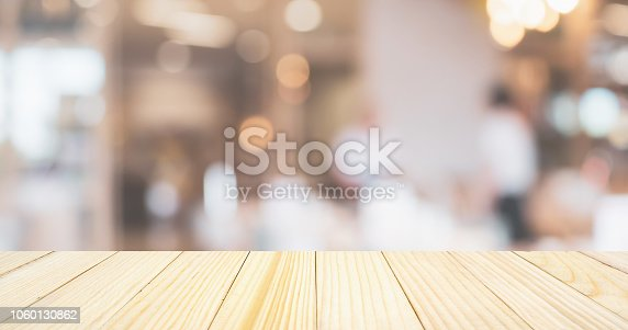 cafe restaurant or coffee shop with abstract bokeh lights defocused blur background with table for product display