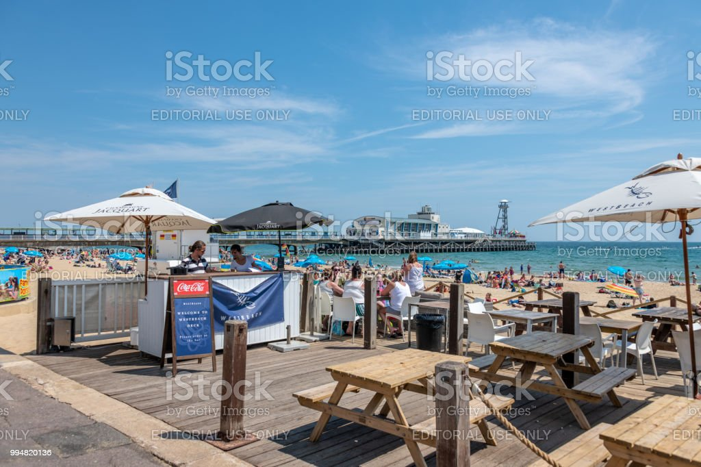 Cafe seating by the beach in Bournemouth stock photo