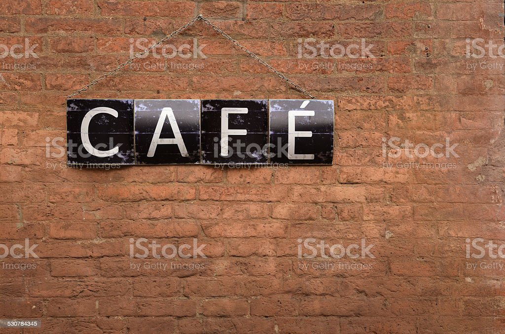 cafe sign on red bricks wall stock photo