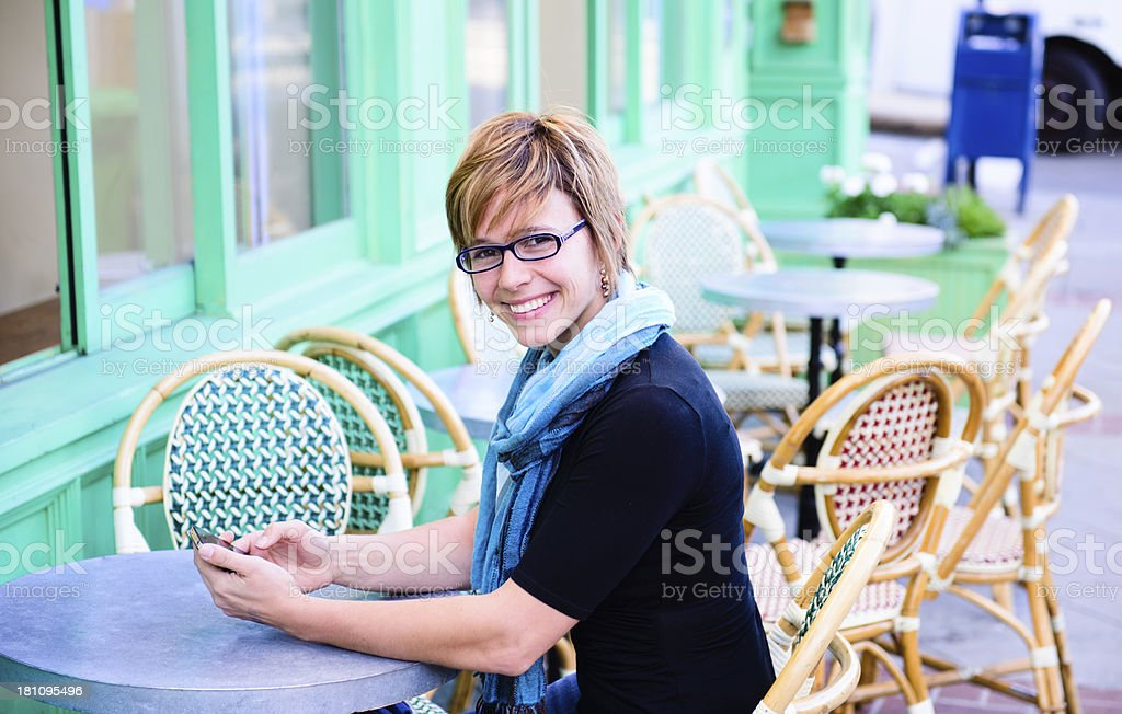 Cafe - Smiling Female royalty-free stock photo