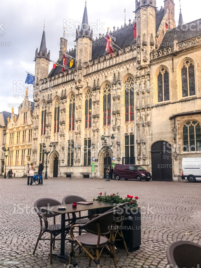 Cafe table in front of Bruges city hall, Belgium stock photo