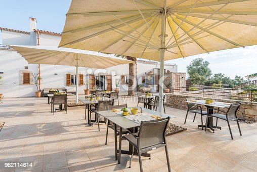 Tables in outdoor terrace from a hotel restaurant in Majorca, Balearic Islands, Spain