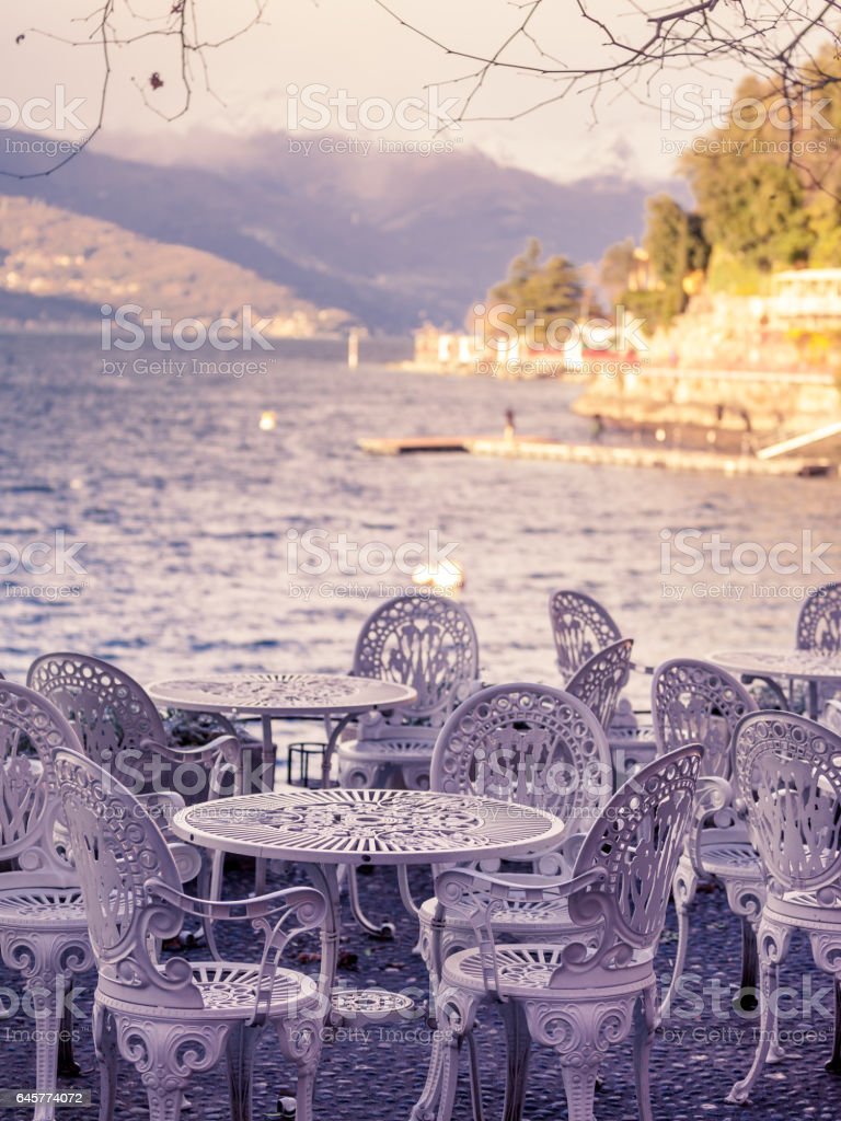 cafe tables on the edge of lake Como stock photo