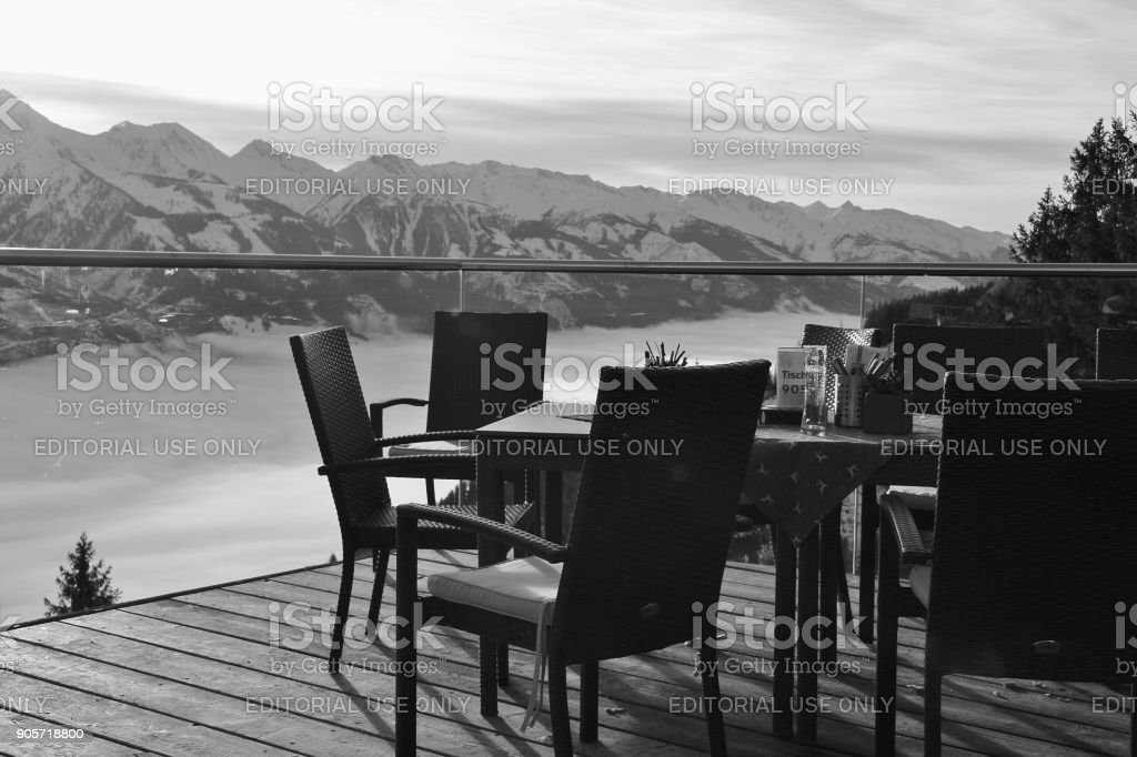 Cafe terrace in the mountains,  and view of the Hohe Tauern mountain range. Austria. stock photo