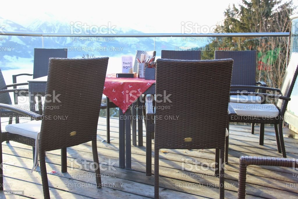 Cafe terrace in the mountains and view of the Hohe Tauern mountain range. Zell am See, Austria. stock photo