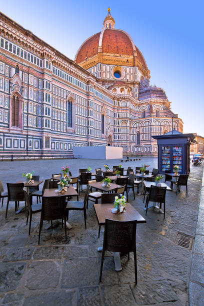 cafe under duomo on square in florence, historic landmark in tuscany refion of italy - cupola stock pictures, royalty-free photos & images