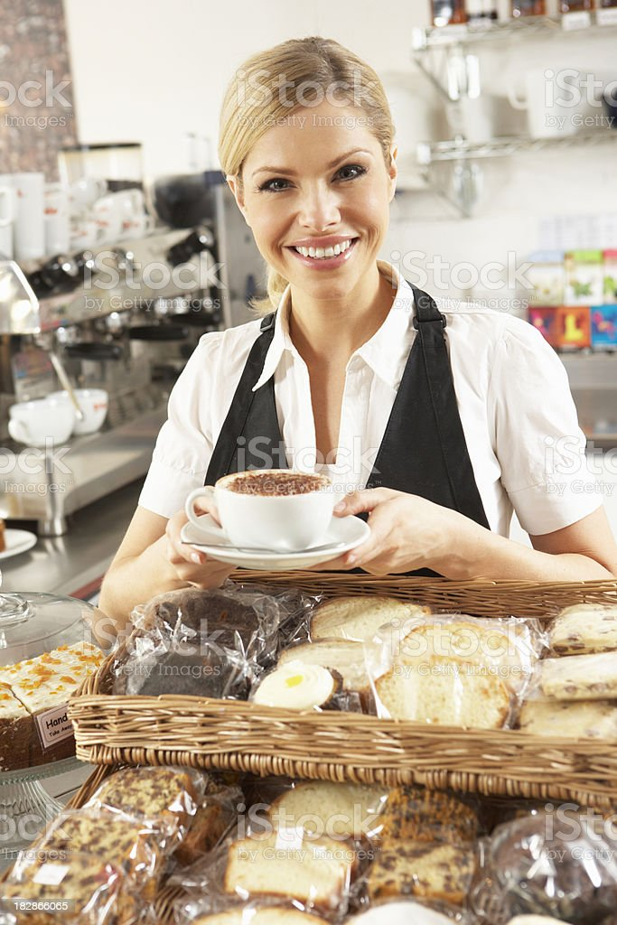 Cafe Waitress Serving In Coffee Shop royalty-free stock photo