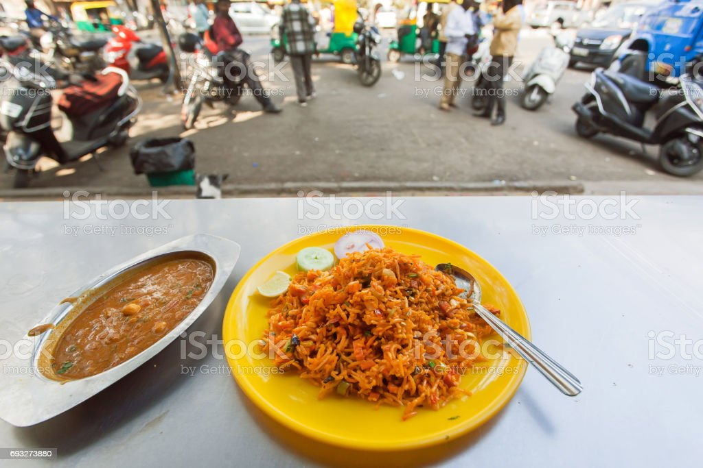 Cafe with street food - indian vegeterian biryani and lentil daal in indian style. stock photo