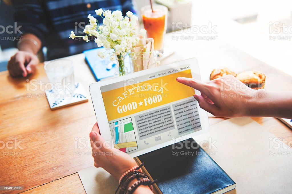 Cafeteria Good Food Critic Review Tablet Technology Concept stock photo