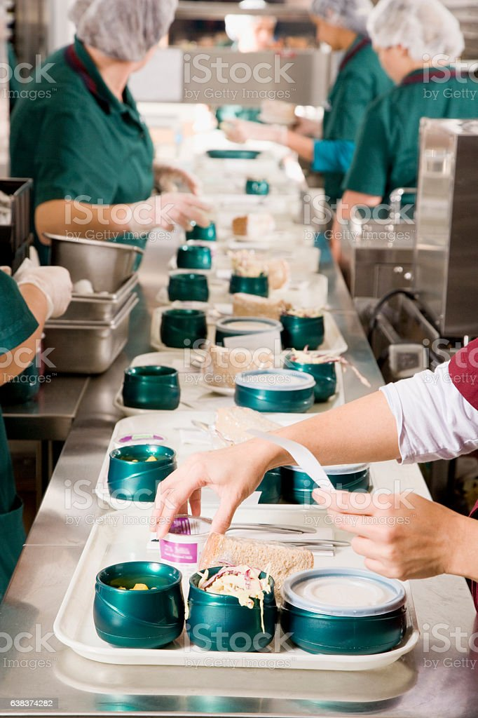 Cafeteria kitchen service cooks preparing meals in hospital stock photo